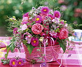Bouquet in pink bast basket