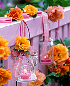 Lantern with tealight and pink (rose) on balcony railing