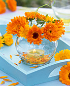 Lantern with wreath of calendula on Turkish table
