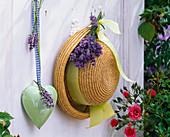 Lavandula bouquet, straw hat, heart with message 'Willkommen'