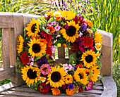 Wreath made of Helianthus (sunflower), Zinnia (Zinnia), Ageratum
