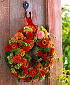 Wreath with zinnia, geranium, sedum
