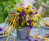 Bouquet of Centaurea (cornflower), Solidago (goldenrod), Erigeron