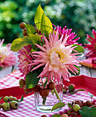 Small bouquet of Dahlia and Malus in bottle