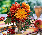 Small bouquet of dahlia, rosehips, berries