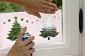 Window decoration with snow spray and template
