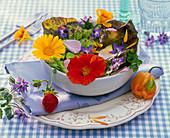 Salad with edible flowers, lactuca, calendula