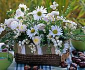 White autumn arrangement in the basket