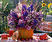 Purple autumn bouquet in pumpkin vase