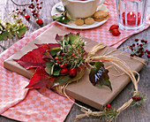 Gift with a small Parthenocissus (wild wine) bouquet
