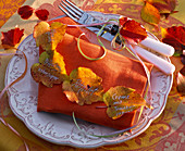 Napkin decoration with autumn leaves of Parthenocissus
