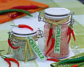 Herbal salt with salt and capsicum in preserving jars with label