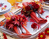 Small wreaths of chrysanthemum and autumn leaves of Acer