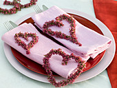 Erica hearts on folded napkins, cutlery, menu plates