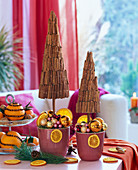 Small trees with cinnamon sticks and Christmas tree decorations