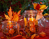 Lanterns filled with juglans, corylus, candles