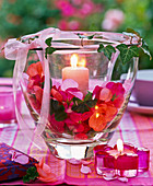 Two nested glasses with pelargonium in the interspace