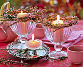 Small wreaths from Calluna around ice cream cup with pink candles