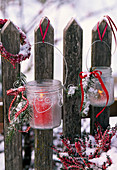 Lanterns with frost-optic spray and Picea (spruce) twigs