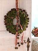 Door wreath made of pinus (pine), covered with cones