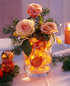 Arrangement of roses in fairy lights