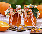 Citrus sinensis jam with doily, paring knife