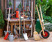 Garden tools on the terrace, shovel, watering can, grave fork, rake, spade