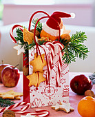 St. Nicholas bag with cookies, candy canes, tangerine