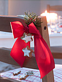 Red bow with cinnamon stars and Pseudotsuga tip
