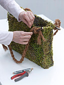 Moss bag with daffodil, moss bag with spring flowers