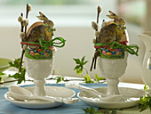 Breakfast eggs in porcelain eggcups, branch of Salix