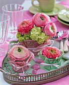 Ranunculus in a cake topping glass