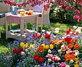Tree slice planted with Tulipa 'Orange Princess' 'Monte Carlo'