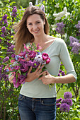 Woman with syringa (lilac), tulipa (tulip) bouquet
