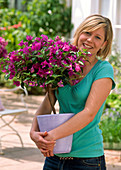 Woman holds bougainvillea