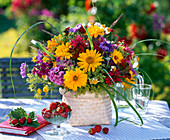 Bouquet made of heliopsis, monarda, phlox