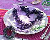Wreath round and in heart shape made of lavandula as napkin decoration