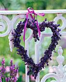 Heart made of dried lavandula (lavender) on balcony railing