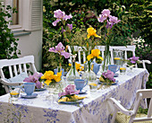 Table decoration with irises and grasses, blue place settings