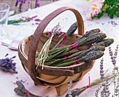 Lavender bottles of dried lavandula (lavender) in basket