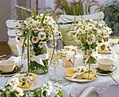 Table decoration with daisies and grasses
