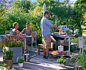 Outdoor kitchen, pots of Origanum (oregano), Rosmarinus