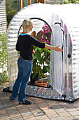 Inflatable greenhouse for wintering potted plants