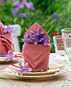 Folded napkins with agapanthus and panicum