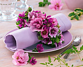 Napkin ring from Malva, Alcea around rolled napkin