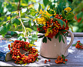 Sorbus and Solidago bouquet and wreath in pitcher