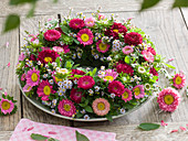 Wreath of summer asters, autumn blackberries and catnip