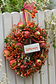 Wreath made of malus (apple), roses (rosehip), clematis vitalba