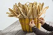 Bucket decorated with corncobs