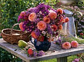 Autumn bouquet made of Dahlia, Aster (winter aconite), Panicum
